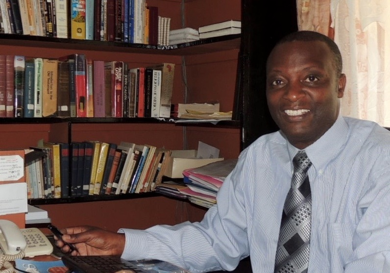 Dr. Paul Kamunge, Principal